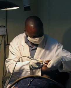 Dental_assistant_workingonpatient